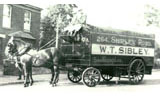 Early Sibley horse-drawn removal wagon